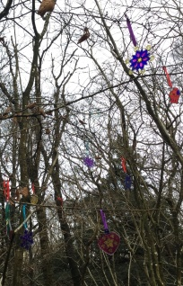 'Decorations have been hung (in the pouring rain!) on the hazel tree by our campfire...'